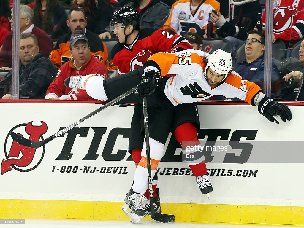 Marek Zidlicky #2 of the New Jersey Devils is hit by Maxime Talbot #25 of the Philadelphia Flyers during the season opener at the Prudential Center on January 22, 2013 in Newark, New Jersey.The New Jersey Devils shut out the Philadelphia Flyers 3-0.