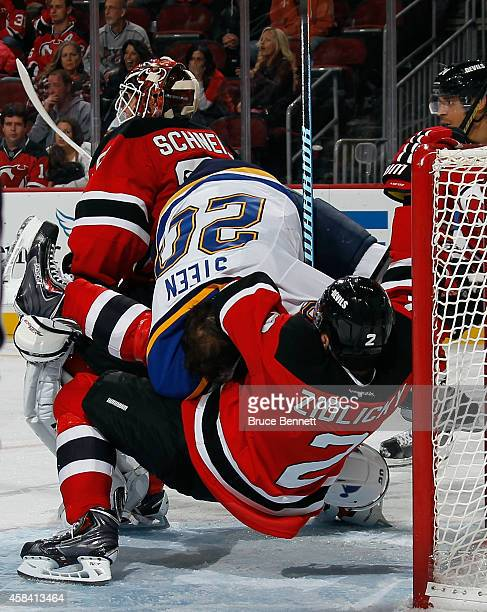 Marek Zidlicky of the New Jersey Devils takes a two minute penalty for holding Alexander Steen of the St Louis Blues during the third period at the...