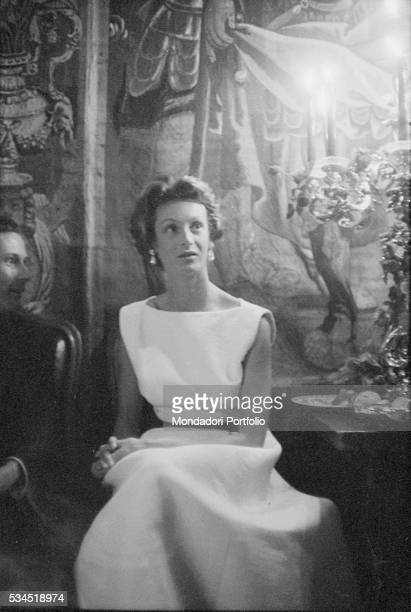 Marella Agnelli wife to Gianni Agnelli attending to a party during the XVIII Venice International Film Festival Venice 1957