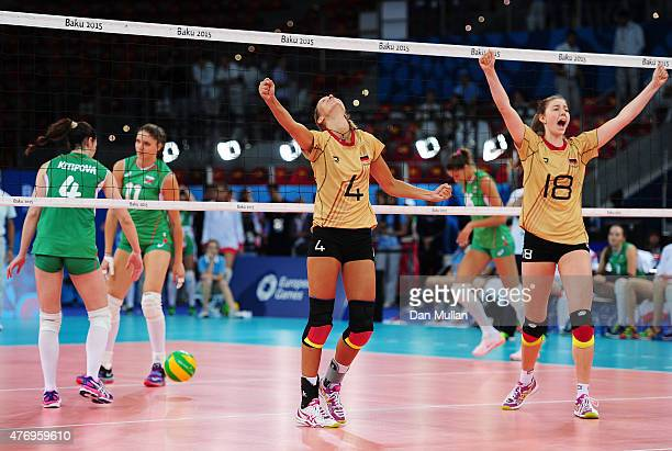 Maren Brinker and Wiebke Silge of Germany celebrates their team's victory in the Women's Volleyball Preliminary Round match against Bulgarisduring...