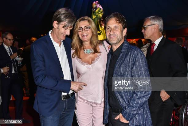 Maren Gilzer, her boyfriend Harry Kuhlmann and Falk Willy Wild attend the 8th Diabetes Charity Gala at Tipi am Kanzleramt on October 18, 2018 in...