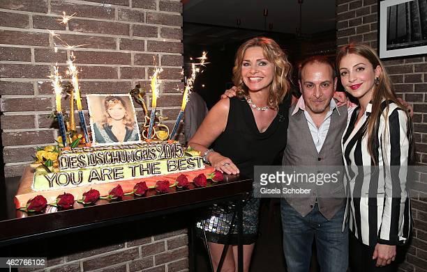 Maren Gilzer with her birthday cake Erdogan Atalay Arzu Bazman during the birthday celebration of Maren Gilzer's 55th birthday on February 4 2015 in...