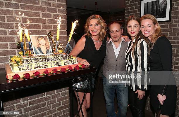 Maren Gilzer with her birthday cake Erdogan Atalay Arzu Bazman Katja Ohneck during the birthday celebration of Maren Gilzer's 55th birthday on...