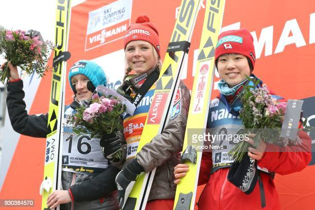 Maren Lundby of Norway celebrates after winning a ski jumping World Cup event in Oslo on March 11 along with runnerup Daniela IraschkoStolz of...