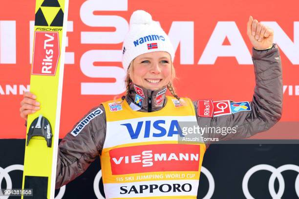 Maren Lundby of Norway celebrates after winning in the Ladies normal hill individual during day one of the FIS Ski Jumping Women's World cup at...