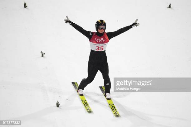 Maren Lundby of Norway celebrates winning gold as she lands her jump during the Ladies' Normal Hill Individual Ski Jumping Final on day three of the...