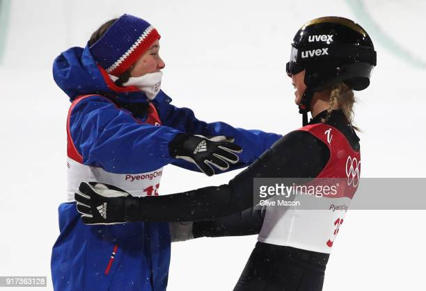 Maren Lundby of Norway celebrates winning gold with Silje Opseth of Norway during the Ladies' Normal Hill Individual Ski Jumping Final on day three...