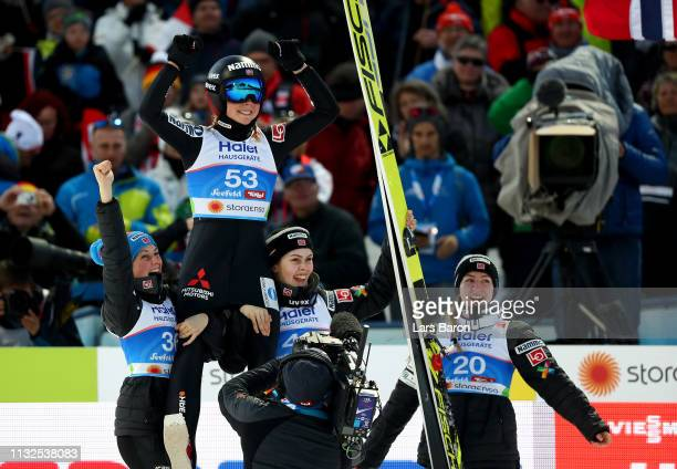 Maren Lundby of Norway celebrates winning the gold medal after the final round of the HS109 women's ski jumping Competition of the FIS Nordic World...