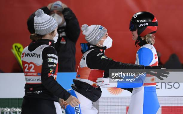 Maren Lundby of Norway celebrates with teammates after winning the Women's Ski Jumping HS137 competition at the FIS Nordic World Ski Championships...