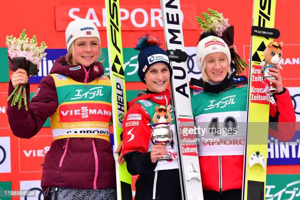 Maren Lundby of Norway , Eva Pinkeling of Austria and Daniela Iraschko-Stolz of Austria smile on the podium during day two of the FIS Ski Jumping...