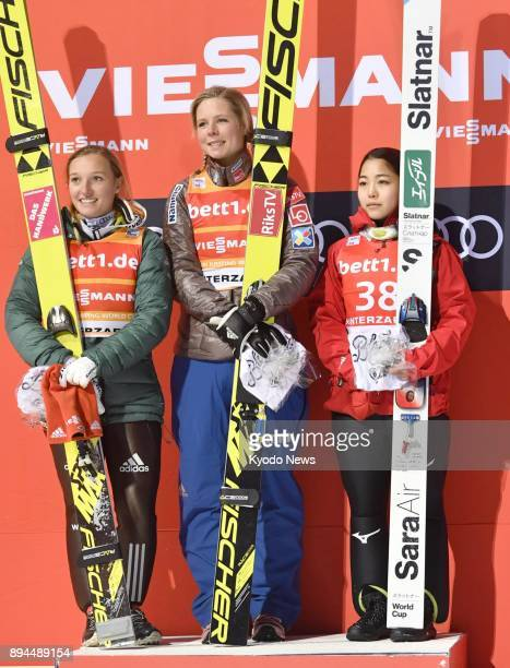 Maren Lundby of Norway poses on the podium after winning a women's individual ski jumping World Cup event in Hinterzarten Germany on Dec 17 alongside...