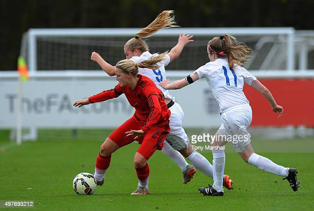 Maren Marie Tellenbroker of Germany is tackled by Nicole Douglas and Lauren Hemp of England during Women's U16s International Friendly match between...