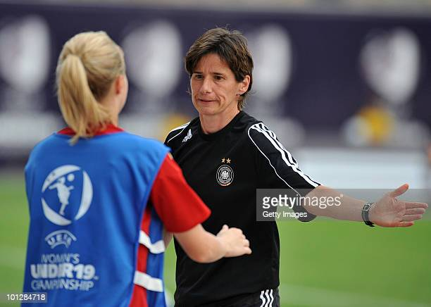 Maren Meinert coach of German national team celenbrates after wining the UEFA Women's Under19 European Championship group A match between England and...