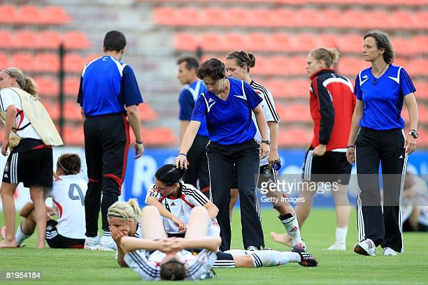 Maren Meinert , coach of Germany, consoles Selina Wagner after the Women's U19 European Championship match between Germany and Norway at Valle du...