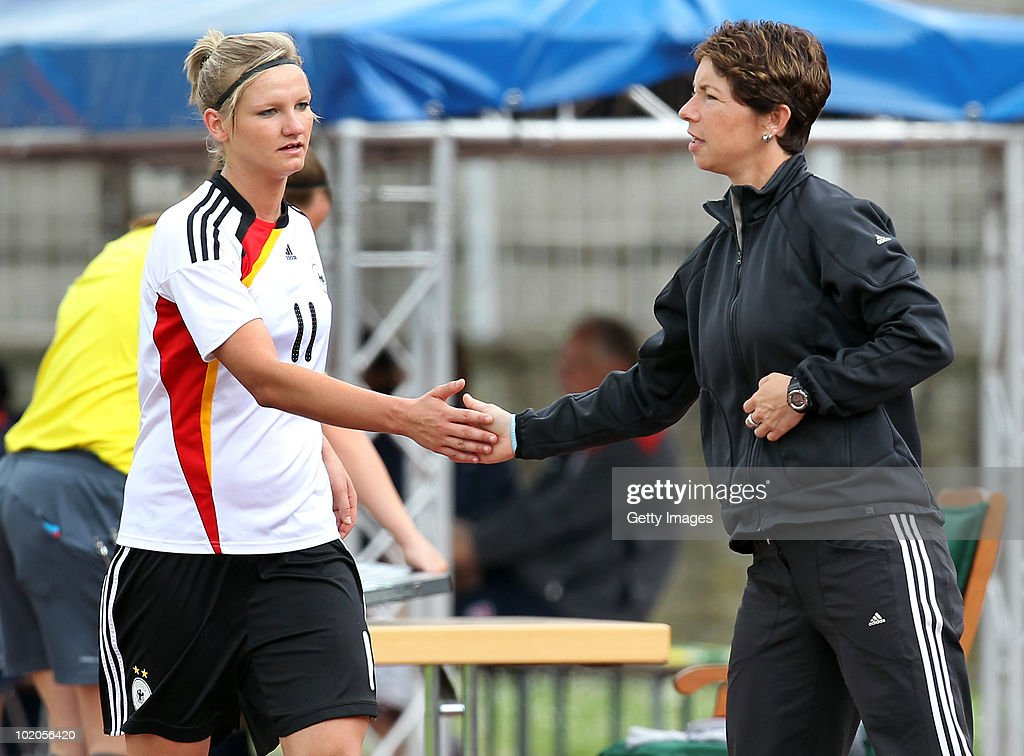 Maren Meinert (R) head coach of Germany and Alexandra Popp (L) clap their hands during the DFB women's U20 match between Germany and USA at the Ludwig-Jahn-Stadion on June 13 2010 in Herford, Gerrmany.