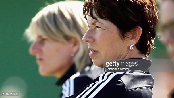 Maren Meinert head coach of Germany and assistant coach Silke Rottenberg look on during the women's U23 international friendly match between England...
