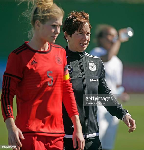 Maren Meinert head coach of Germany and Rebecca Knaak team's captain of Germany react dejected after losing the women's U23 international friendly...