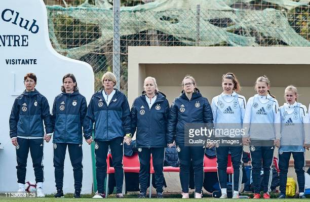 Maren Meinert head coach of Germany and their assisstent during the National Anthem protocol before 14 Nations Tournament match between U19 Women's...