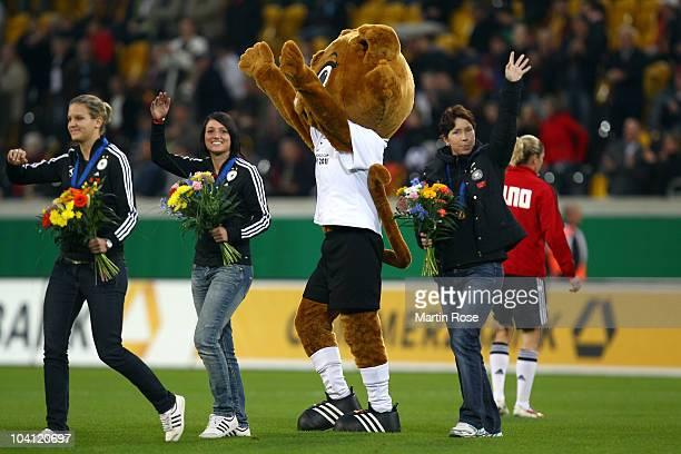 Maren Meinert head coach the the German Women U 20 team seen during a lap of hounor during the half time of the Women's International Friendly match...