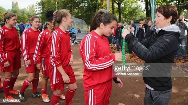 Maren Meinert sports adiministration hands out gold medals to team members of Hesse during the U18 Girl's Federal Cup at Sport School Wedau on...