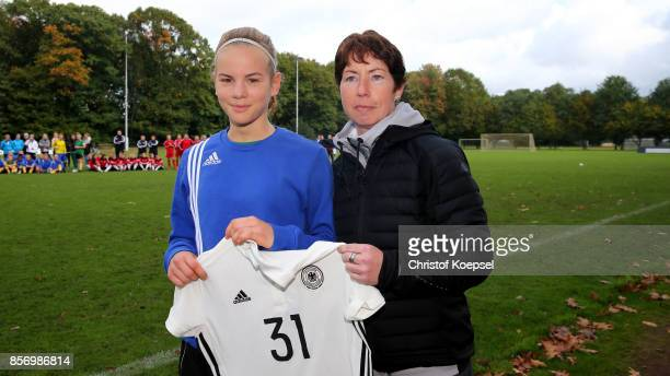 Maren Meinert sports administration hands out a jersey to the best goalgetter Jule Symann of LowerRhine during the U18 Girl's Federal Cup at Sport...