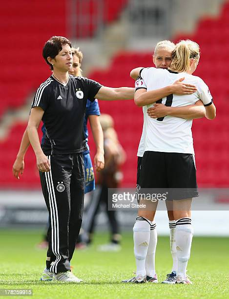 Maren Meinert the coach of Germany U19 looks on at Pauline Bremer and Johanna Tietge after her sides 12 defeat during the UEFA Women's U19 Semi Final...