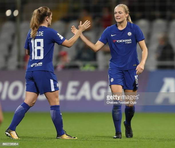 Maren Mjelde and Magdalena Ericsson of Chelsea FC react during the Champions League round of 32 second leg match between FC Bayern Muenchen and...
