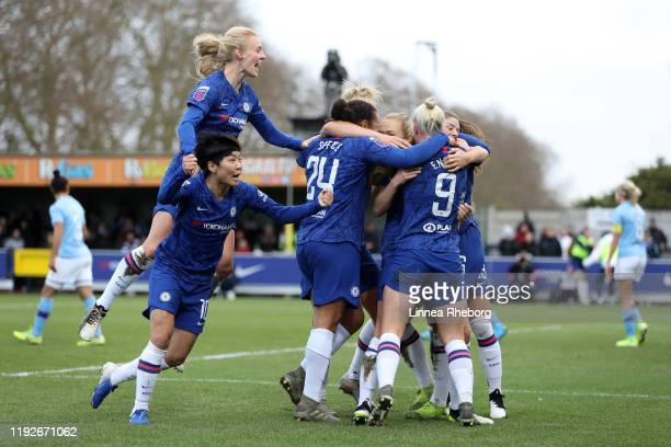 Maren Mjelde of Chelsea celebrates with team mates after scoring her sides second goal during the Barclays FA Women's Super League match between...