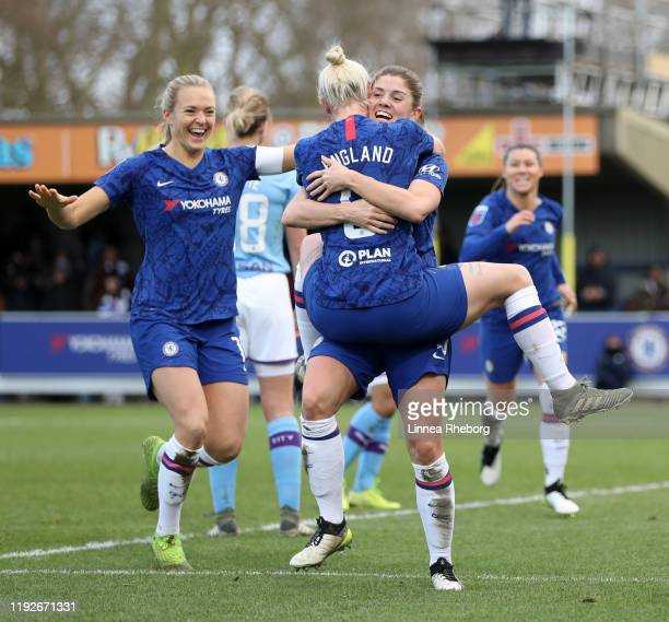 Maren Mjelde of Chelsea celebrates with team mates Bethany England and Magdalena Eriksson after scoring her sides second goal during the Barclays FA...