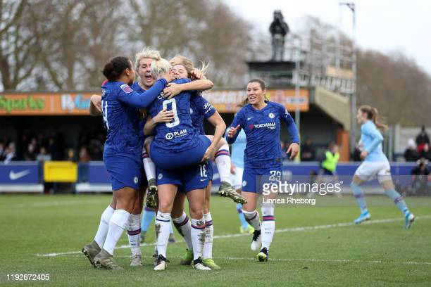 Maren Mjelde of Chelsea celebrates with teammates after scoring her sides second goal during the Barclays FA Women's Super League match between...