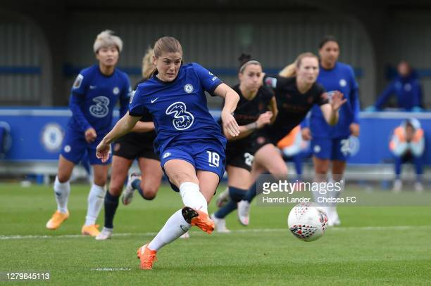 Maren Mjelde of Chelsea scores a penalty for her team's first goal during the Barclays FA Women's Super League match between Chelsea Women and...