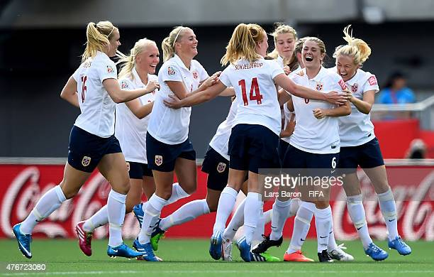Maren Mjelde of Norway celebrates with team mates after scoring her teams first goal during the FIFA Women's World Cup 2015 Group B match between...