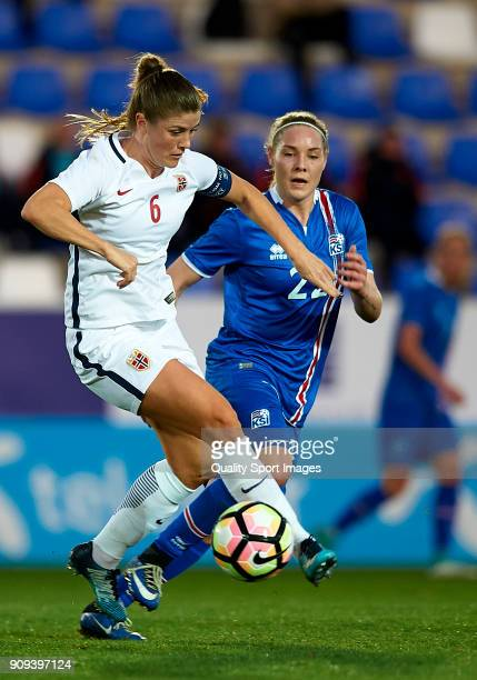 Maren Mjelde of Norway competes for the ball with Rakel Honnudottir of Iceland during the international friendly match between Norway Women and...