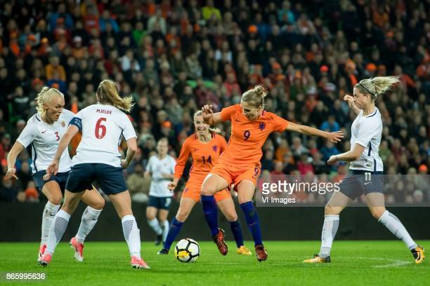 Maren Mjelde of Norway Vivianne Miedema of the Netherlands Ingrid Marie Spord of Norway Maria Thorisdottir of Norway during the FIFA Women's World...