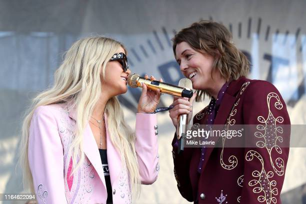 Maren Morris and Brandi Carlile perform as part of the Collaboration during day two of the 2019 Newport Folk Festival at Fort Adams State Park on...