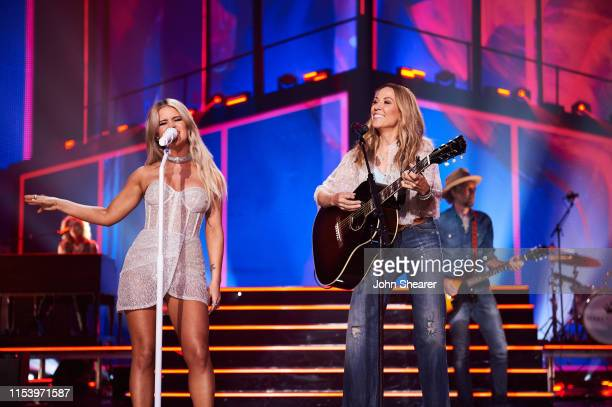 Maren Morris and Sheryl Crow perform at the 2019 CMT Music Awards at Bridgestone Arena on June 05 2019 in Nashville Tennessee