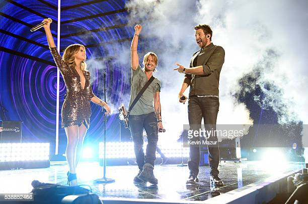 Maren Morris Keith Urban and Brett Eldredge perform onstage during the 2016 CMT Music awards at the Bridgestone Arena on June 8 2016 in Nashville...