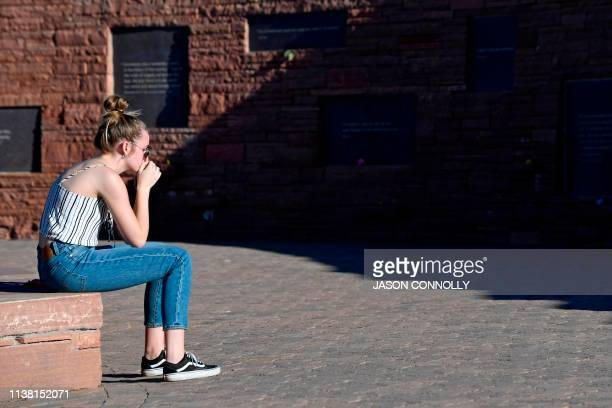 Maren Strother of Denver Colorado reflects while visiting the Columbine Memorial at Clement Park in Littleton Colorado before a community vigil for...