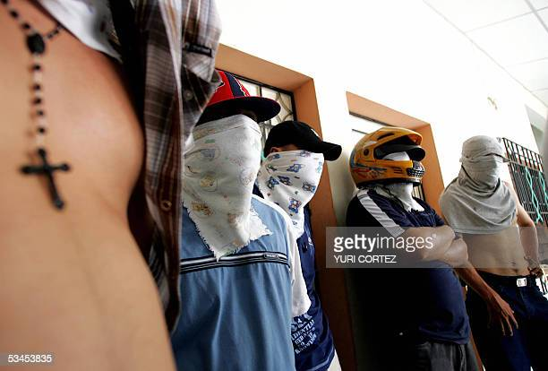Mareros of the Mara Salvatrucha gang with their heads and faces covered take part in a press conference 23 August 2005 in San Miguel 139 kilometers...