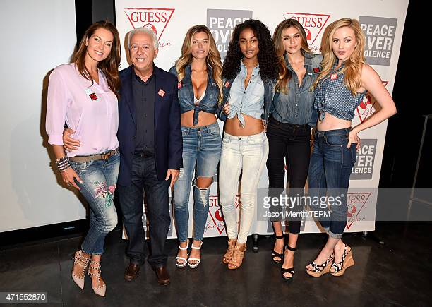 Mareva Georges Marciano and CEO and Creative Director of GUESS Inc Paul Marciano with GUESS models during the GUESS and Peace Over Violence press...