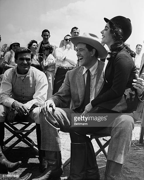 Rock Hudson and Elizabeth Taylor are shown surrounded by a group of fans while on location in Marfa Texas where sequences are being filmed for Giant...