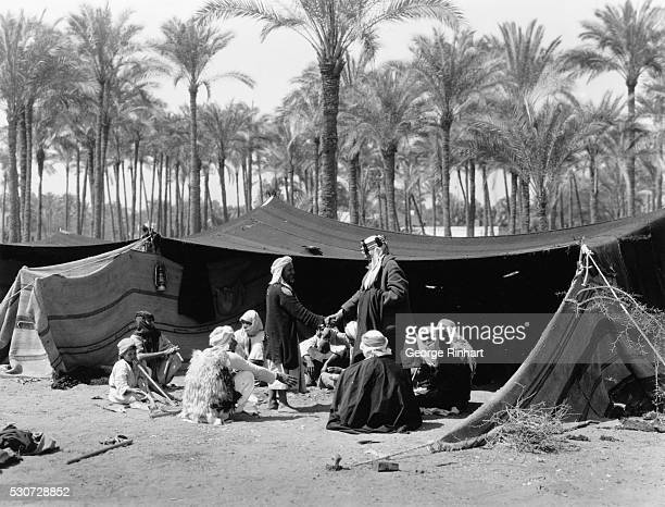 A Bedouin chief entertaining visitors at coffee in the forests of Marg Undated photo