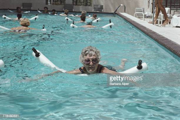 Margaret Alper taking part in a water aerobics class in a swimming pool at the Safety Harbor Resort and Spa in Clearwater, Florida, June 1989.