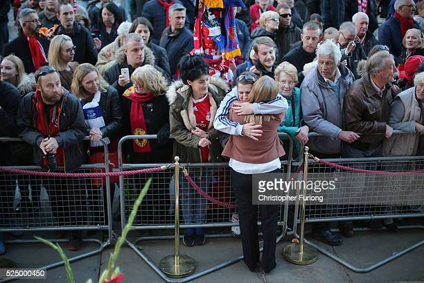Margaret Aspinall is hugged by members of the public as thousands gather outside Liverpool's Saint George's Hall as they attend a vigil for the 96...