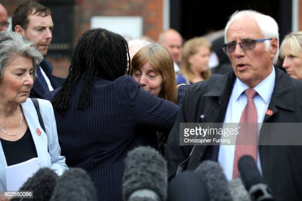 Margaret Aspinall of the Hillsborough Family Support Group hugs Lawyer Marcia Willis Stewart as Trevor Hicks addresses the media after the families...