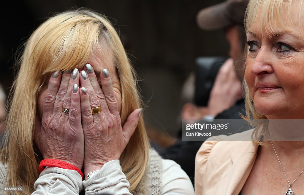 Margaret Aspinall, who lost her son James reacts alongside Jenni Hicks (R) who lost her two teenage daughters Sarah and Victoria, as they gather with the families of the 96 football fans who lost their lives in the Hillsborough Disaster outside the High Court on December 19, 2012 in London, England. An application presented by the attorney general, Dominic Grieve to Lord Chief Justice, Lord Judge has resulted in the quashing of the original accidental death verdict and an order for fresh inquests. The Hillsborough disaster occurred during the FA Cup semi-final tie between Liverpool and Nottingham Forest football clubs in April 1989 at the Hillsborough Stadium in Sheffield, which resulted in the deaths of 96 football fans.