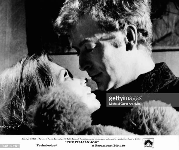Margaret Blye and Michael Caine looking each other's eyes in a scene from the film 'The Italian Job' 1969