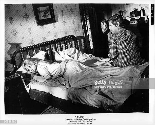 Margaret Blye And Peter Lazer on bed in a scene from the film 'Hombre' 1967