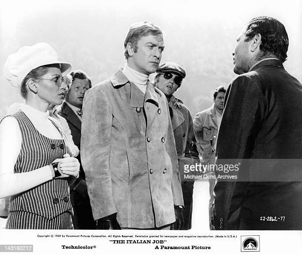 Margaret Blye Benny Hill Michael Caine and Michael Standing looking at unidentified man talking in a scene from the film 'The Italian Job' 1969