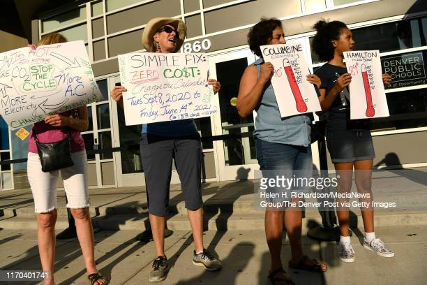 Margaret Bobb second from left a retired DPS secondary science teacher holds up a sign as she joins other teachers and community supporters in a...